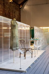Full Grown's Edwardes Grown Chair stands in an exhibition space. Diana Scherer's root dress is next to it.